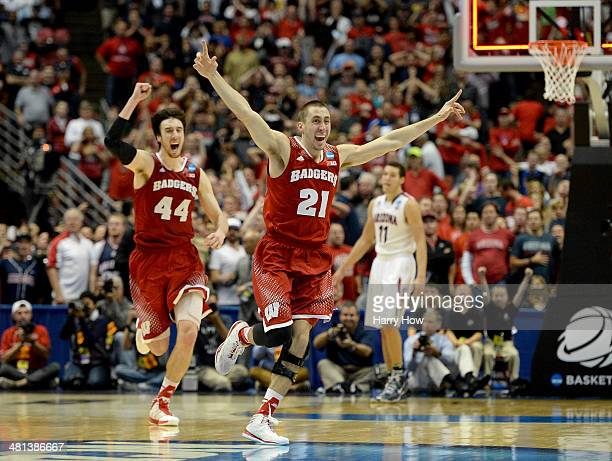 Josh Gasser and Frank Kaminsky of the Wisconsin Badgers celebrate after defeating the Arizona Wildcats 6463 in overtime during the West Regional...