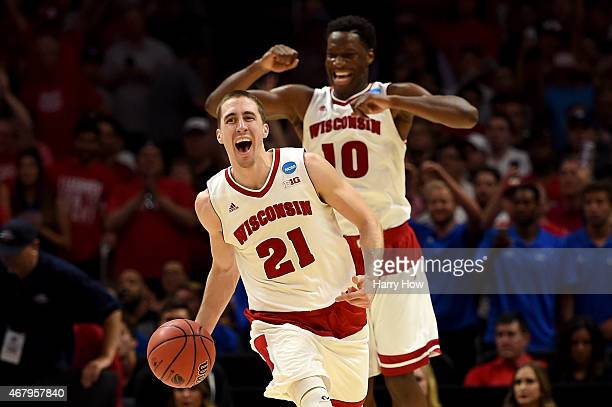 Josh Gasser and Nigel Hayes of the Wisconsin Badgers celebrate the Badgers 8578 win against the Arizona Wildcats during the West Regional Final of...