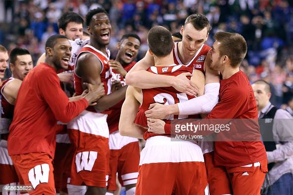 Josh Gasser and Sam Dekker of the Wisconsin Badgers celebrate with teammates after defeating the Kentucky Wildcats during the NCAA Men's Final Four...