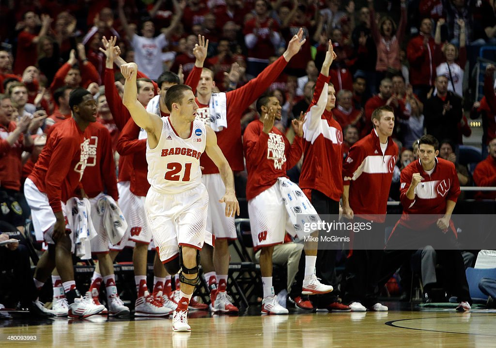 Josh Gasser of the Wisconsin Badgers celebrates a three point shot in the second half against the Oregon Ducks during the third round of the 2014...