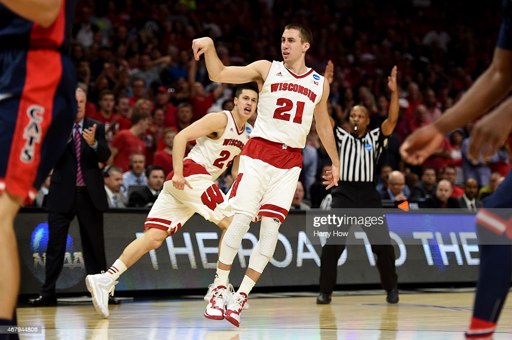 <a gi-track='captionPersonalityLinkClicked' href=/galleries/search?phrase=Josh+Gasser&family=editorial&specificpeople=7355332 ng-click='$event.stopPropagation()'>Josh Gasser</a> #21 of the Wisconsin Badgers reacts after making a three-pointer in the second half against the Arizona Wildcats during the West Regional Final of the 2015 NCAA Men's Basketball Tournament at Staples Center on March 28, 2015 in Los Angeles, California.