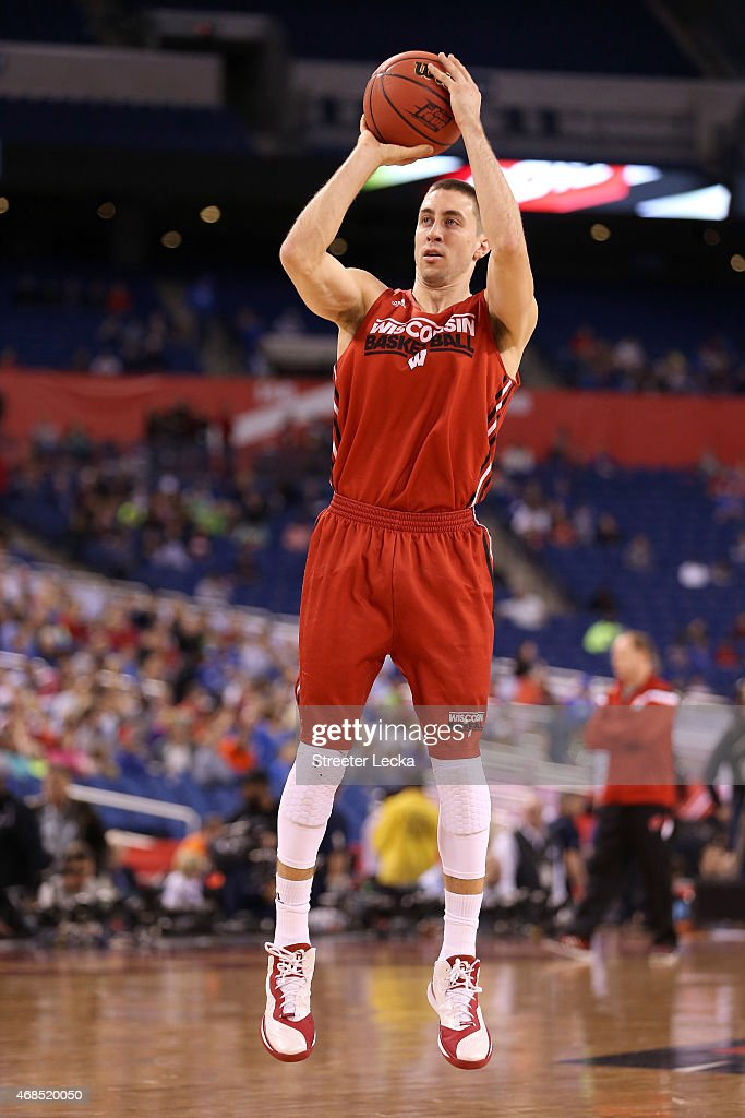 <a gi-track='captionPersonalityLinkClicked' href=/galleries/search?phrase=Josh+Gasser&family=editorial&specificpeople=7355332 ng-click='$event.stopPropagation()'>Josh Gasser</a> #21 of the Wisconsin Badgers shoots during practice for the NCAA Men's Final Four at Lucas Oil Stadium on April 3, 2015 in Indianapolis, Indiana.