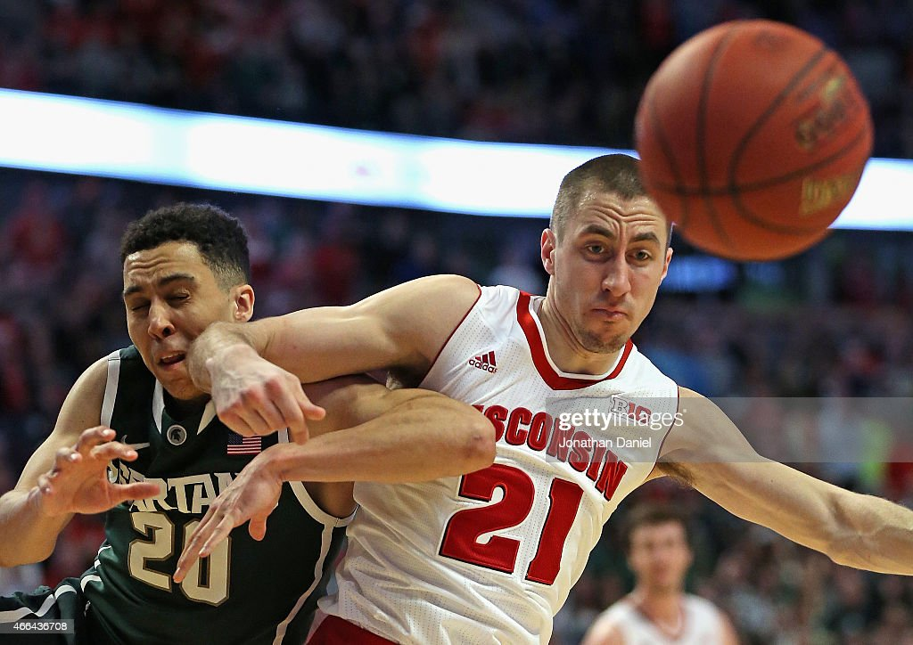 <a gi-track='captionPersonalityLinkClicked' href=/galleries/search?phrase=Josh+Gasser&family=editorial&specificpeople=7355332 ng-click='$event.stopPropagation()'>Josh Gasser</a> #21 of the Wisconsin Badgers throws an elbow into Travis Trice #20 of the Michigan State Spartans as they chase loose ball during the Championship game of the 2015 Big Ten Men's Basketball Tournament at the United Center on March 15, 2015 in Chicago, Illinois. Wisconsin defeated Michigan State 80-69 in overtime.