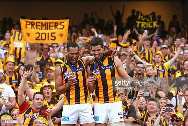 Josh Gibson and Ben Stratton of the Hawks celebrate with the crowd after winning the 2015 AFL Grand Final match between the Hawthorn Hawks and the...
