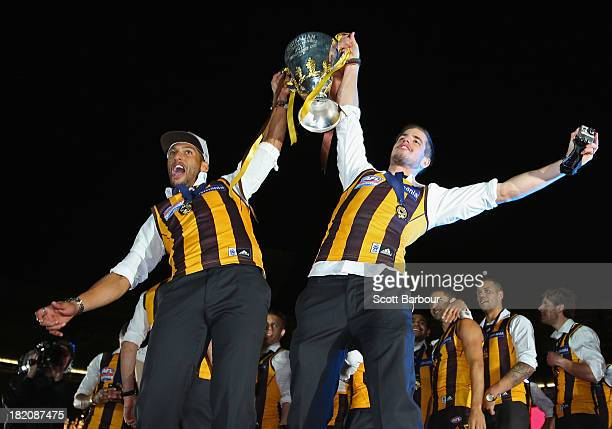 Josh Gibson and Ben Stratton of the Hawks celebrate with the Premiership Cup during the post match AFL Grand Final party at the Melbourne Cricket...