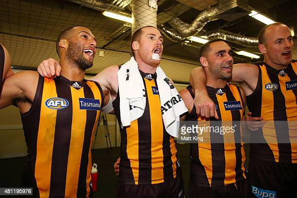 Josh Gibson Jarryd Roughead and Shaun Burgoyne of the Hawks sing the club song after during the round 16 AFL match between the Sydney Swans and the...