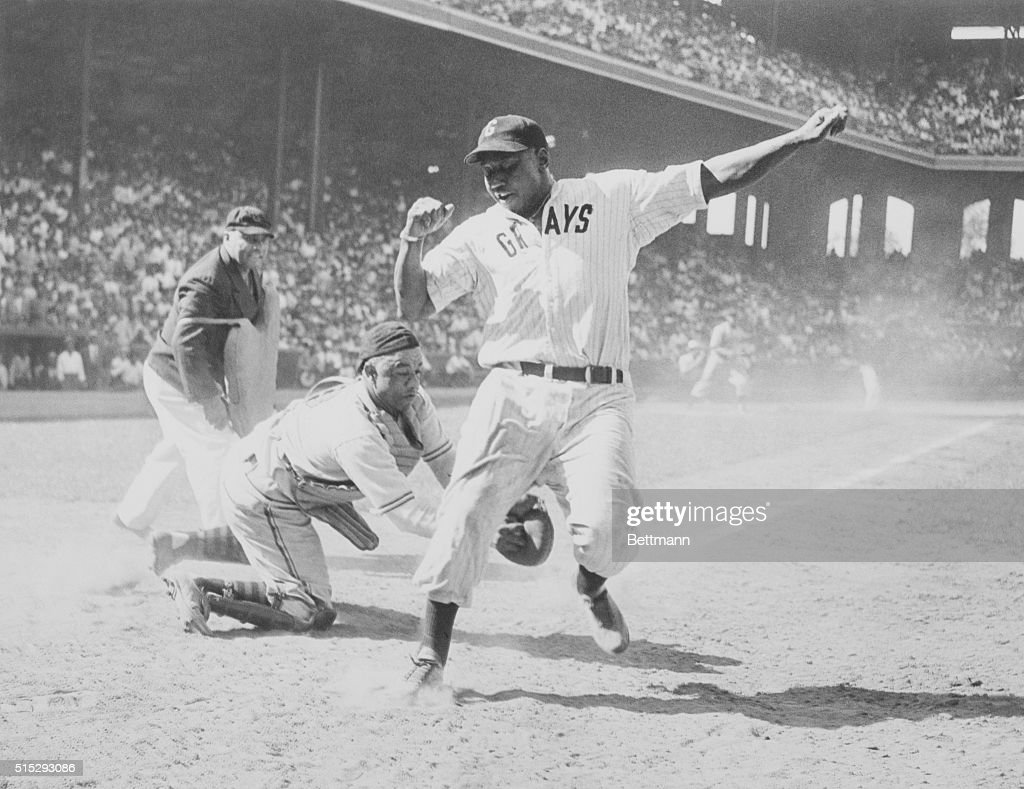 Josh Gibson of East is out at home in the fourth inning of the 12th annual EastWest All Star Negro baseball game at Comiskey Park Gibson was put out...