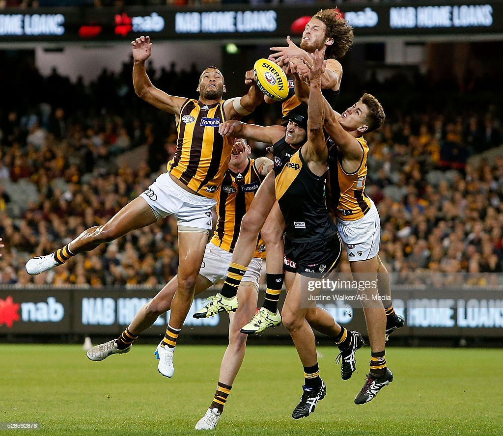 Josh Gibson of the Hawks and Ty Vickery of the Tigers contest the marks during the 2016 AFL Round 07 match between the Richmond Tigers and the Hawthorn Hawks at the Melbourne Cricket Ground, Melbourne on May 6, 2016.