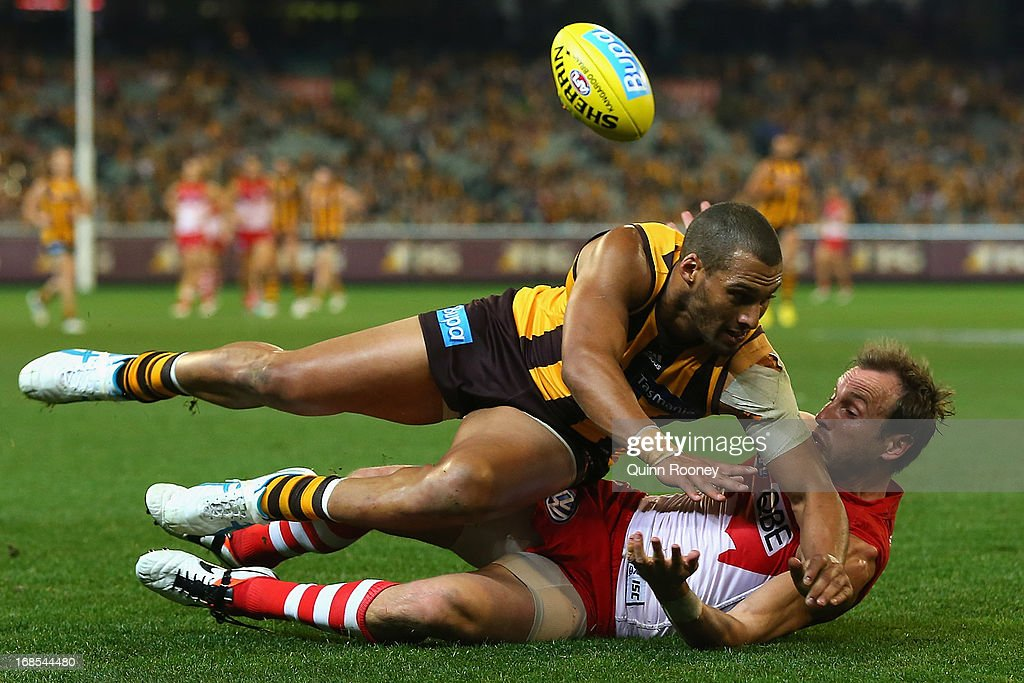 Josh Gibson of the Hawks bumps <a gi-track='captionPersonalityLinkClicked' href=/galleries/search?phrase=Jude+Bolton&family=editorial&specificpeople=213481 ng-click='$event.stopPropagation()'>Jude Bolton</a> of the Swans during the round seven AFL match between the Hawthorn Hawks and the Sydney Swans at Melbourne Cricket Ground on May 11, 2013 in Melbourne, Australia.