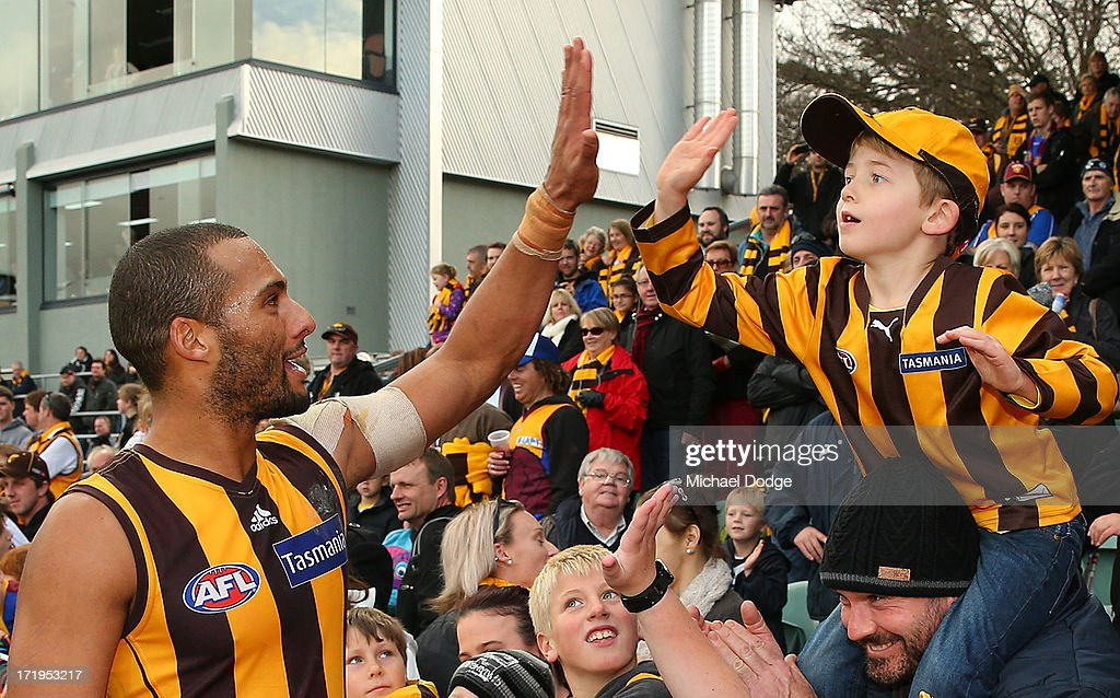 Josh Gibson of the Hawks celebrates the win with fans during the round 14 AFL match between the Hawthorn Hawks and the Brisbane Lions at Aurora Stadium on June 30, 2013 in Launceston, Australia.