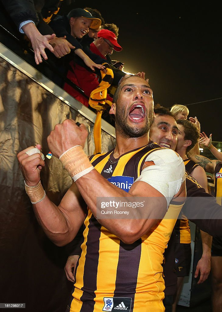 Josh Gibson of the Hawks celebrates winning the AFL First Preliminary FInal match between the Hawthorn Hawks and the Geelong Cats at Melbourne Cricket Ground on September 20, 2013 in Melbourne, Australia.