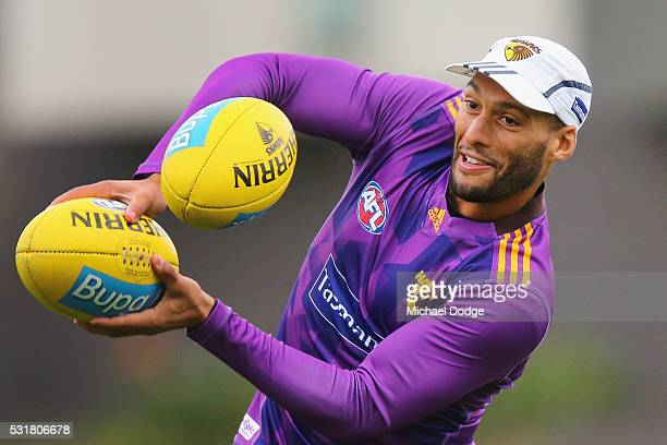 Josh Gibson of the Hawks hits a ball back cricket style during a Hawthorn Hawks AFL training session at Waverley Park on May 17 2016 in Melbourne...