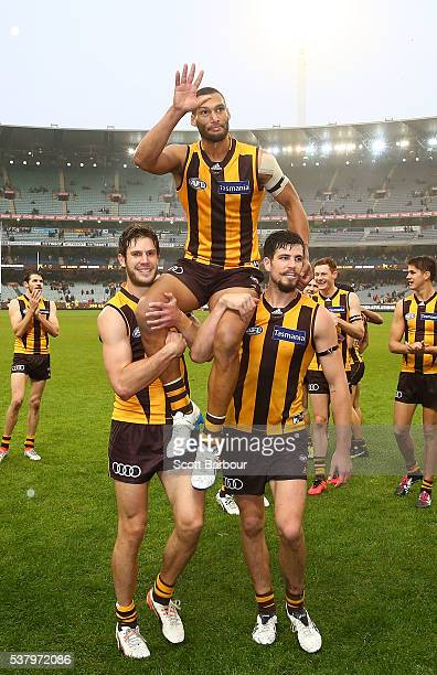 Josh Gibson of the Hawks is chaired off the field after playing his 200th game during the round 11 AFL match between the Hawthorn Hawks and Melbourne...