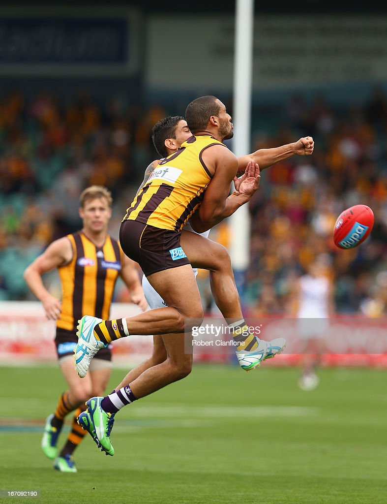 Josh Gibson of the Hawks is challenged for the ball by Michael Walters of the Dockers during the round four AFL match between the Hawthorn Hawks and the Fremantle Dockers at Aurora Stadium on April 20, 2013 in Launceston, Australia.