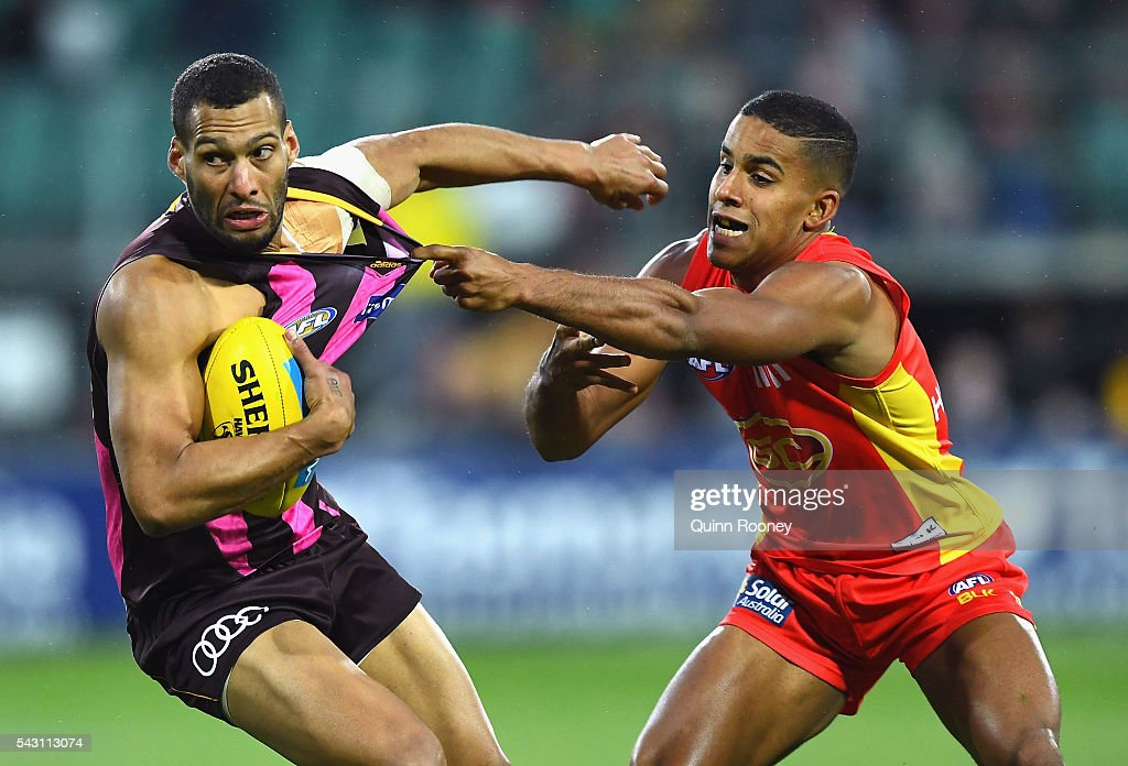 Josh Gibson of the Hawks is tackled by Touk Miller of the Suns during the round 14 AFL match between the Hawthorn Hawks and the Gold Coast Suns at Aurora Stadium on June 26, 2016 in Launceston, Australia.