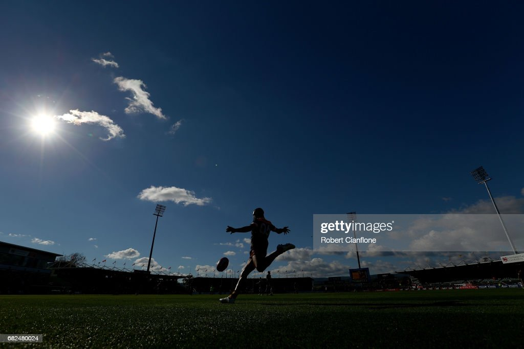 Josh Gibson of the Hawks kicks the ball ahead of the round eight AFL match between the Hawthorn Hawks and the Brisbane Lions at University of Tasmania Stadium on May 13, 2017 in Launceston, Australia.