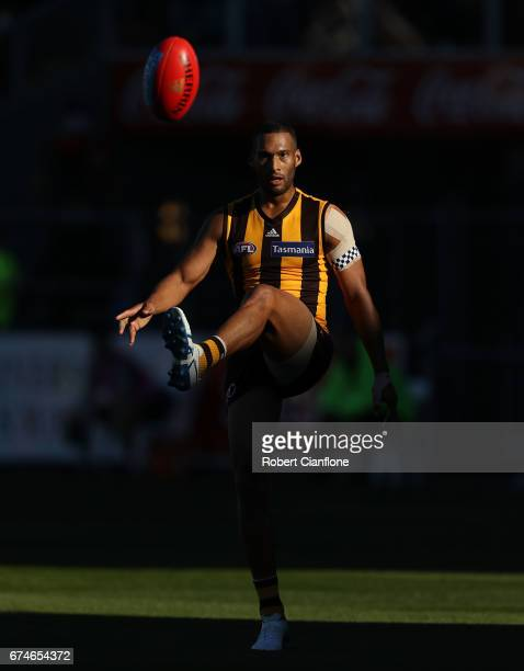 Josh Gibson of the Hawks kicks the ball during the round six AFL match between the Hawthorn Hawks and the St Kilda Saints at University of Tasmania...