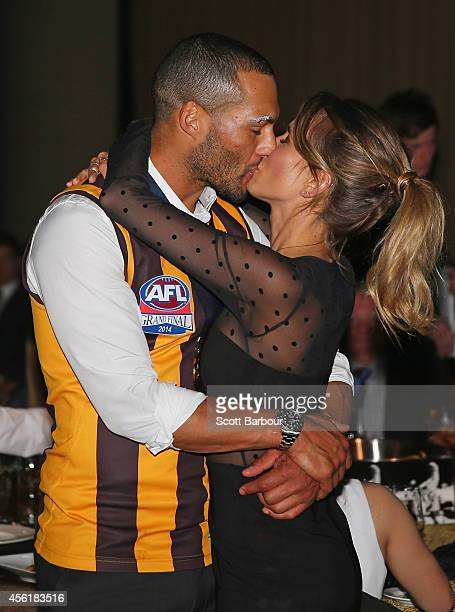 Josh Gibson of the Hawks kisses his girlfriend as they attend the Hawthorn Hawks AFL Grand Final function at Crown Palladium on September 27 2014 in...