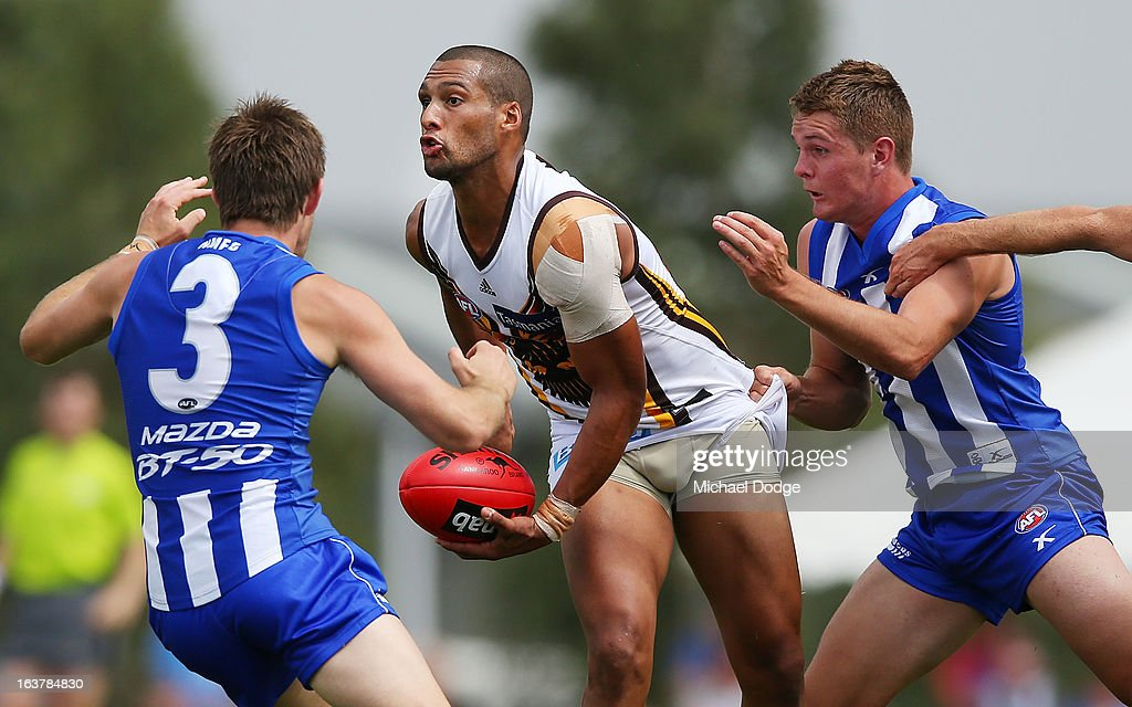 Josh Gibson of the Hawks looks to handpass the ball during the AFL NAB Cup match between the North Melbourne Kangaroos and the Hawthorn Hawks at Highgate Recreational Reserve on March 16, 2013 in Craigieburn, Australia.