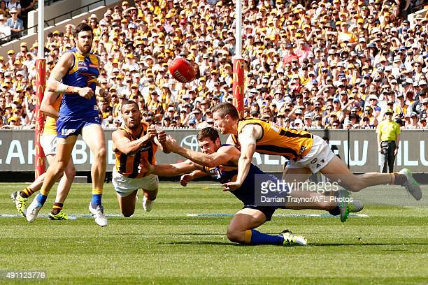 Josh Gibson of the Hawks punches the ball clear of Jack Darling of the Eagles during the 2015 AFL Grand Final match between the Hawthorn Hawks and...