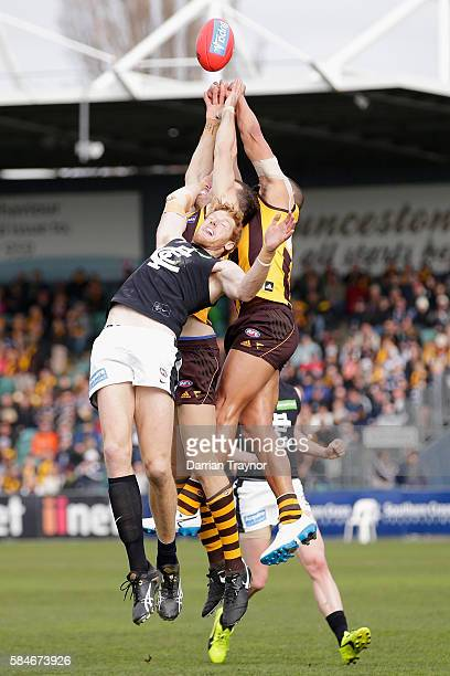 Josh Gibson of the Hawks spoils the ball during the round 19 AFL match between the Hawthorn Hawks and the Carlton Blues at Aurora Stadium on July 30...