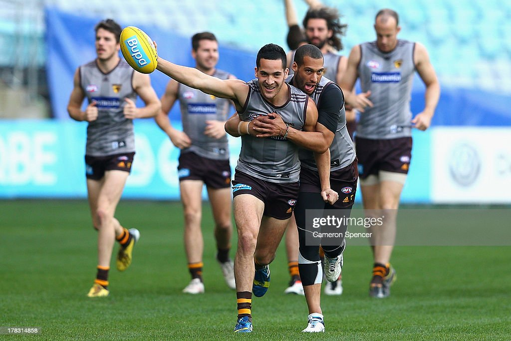 Josh Gibson of the Hawks tackles Shane Savage of the Hawks during a Hawthorn Hawks AFL training session at ANZ Stadium on August 29, 2013 in Sydney, Australia.
