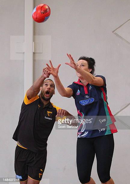 Josh Gibson of the Hawthorn Hawks AFL team plays Aussie Rules Football against Melbourne Vixens Captain Bianca Chatfield at the VIS indoor court...