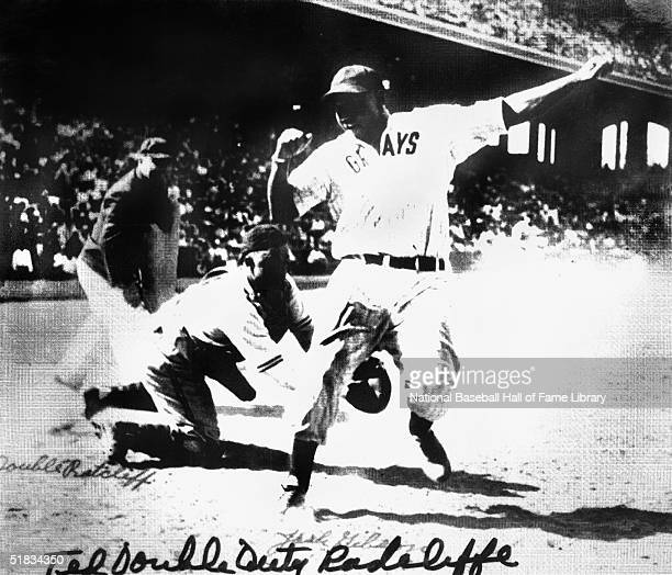 Josh Gibson of the Homestead Grays gets by the tag of catcher Ted 'Double Duty' Radcliffe of the Pittsburgh Crawfords during a circa 1937 Negro...