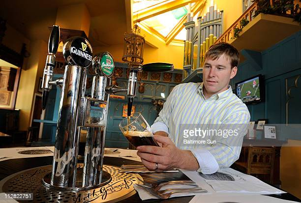 Josh Goodman director of US Operations for Ellickson International pours a pint of Smithwick's Irish Ale from the table beer tap at Tir Na Nog an...