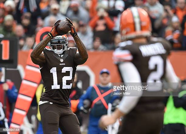 Josh Gordon makes a catch on a ball thrown by Johnny Manziel of the Cleveland Browns during the second quarter against the Cincinnati Bengals at...