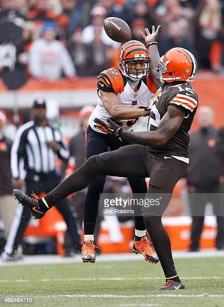 Josh Gordon of the Cleveland Browns can't make a catch in front of Leon Hall of the Cincinnati Bengals during the second quarter at FirstEnergy...
