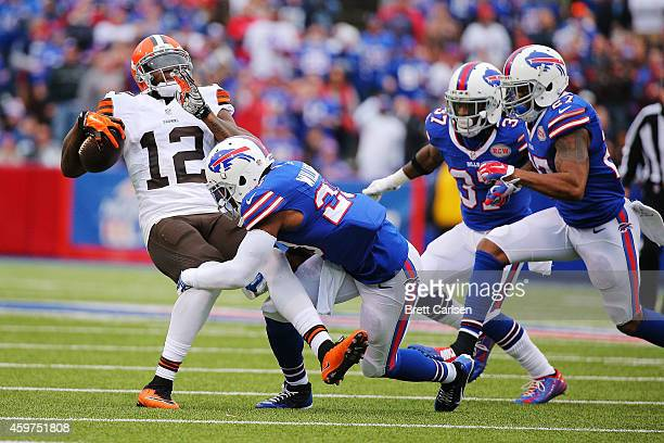 Josh Gordon of the Cleveland Browns is tackled by Aaron Williams of the Buffalo Bills during the first half at Ralph Wilson Stadium on November 30...