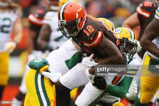 Josh Gordon of the Cleveland Browns is tackled by Damarious Randall of the Green Bay Packers in the second quarter at FirstEnergy Stadium on December...
