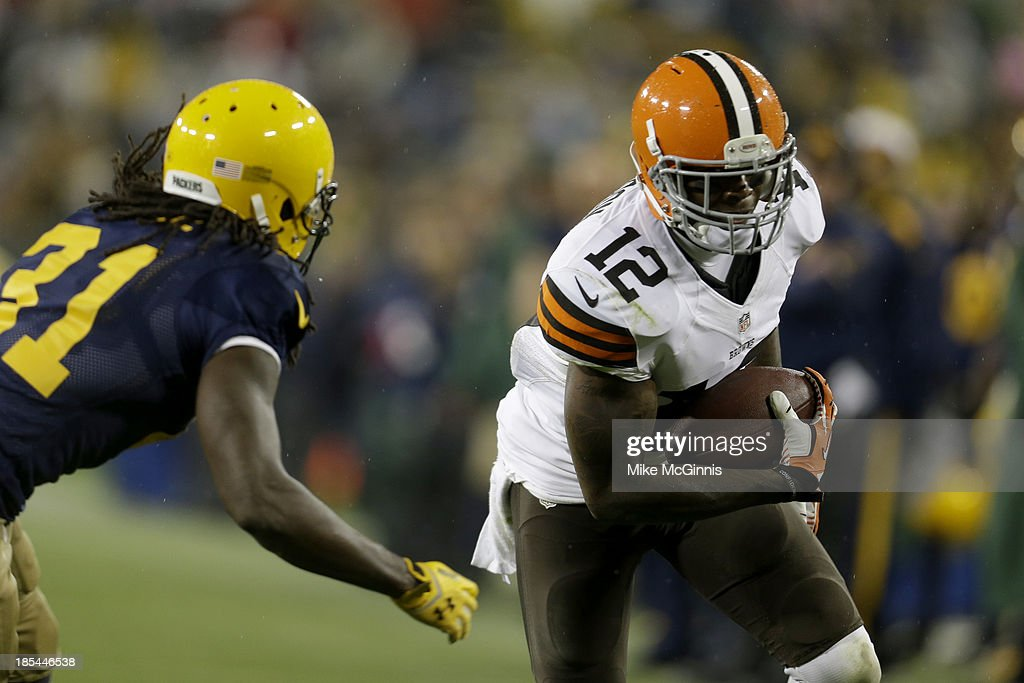 Josh Gordon #12 of the Cleveland Browns makes the catch and runs upfield before getting tackled by <a gi-track='captionPersonalityLinkClicked' href=/galleries/search?phrase=Davon+House&family=editorial&specificpeople=7698158 ng-click='$event.stopPropagation()'>Davon House</a> #31 of the Green Bay Packers during the game at Lambeau Field on October 20, 2013 in Green Bay, Wisconsin.