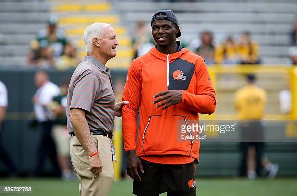 Josh Gordon of the Cleveland Browns talks with team owner Jimmy Haslam before the game against the Green Bay Packers at Lambeau Field on August 12...