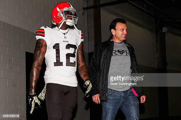 Josh Gordon of the Cleveland Browns walks with his agent Drew Rosenhaus prior to the game against the Atlanta Falcons at Georgia Dome on November 23...