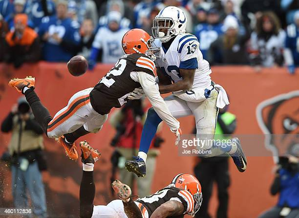 Josh Gordy intercepts a pass intended for Travis Benjamin of the Cleveland Browns alongside LaRon Landry of the Indianapolis Colts during the fourth...