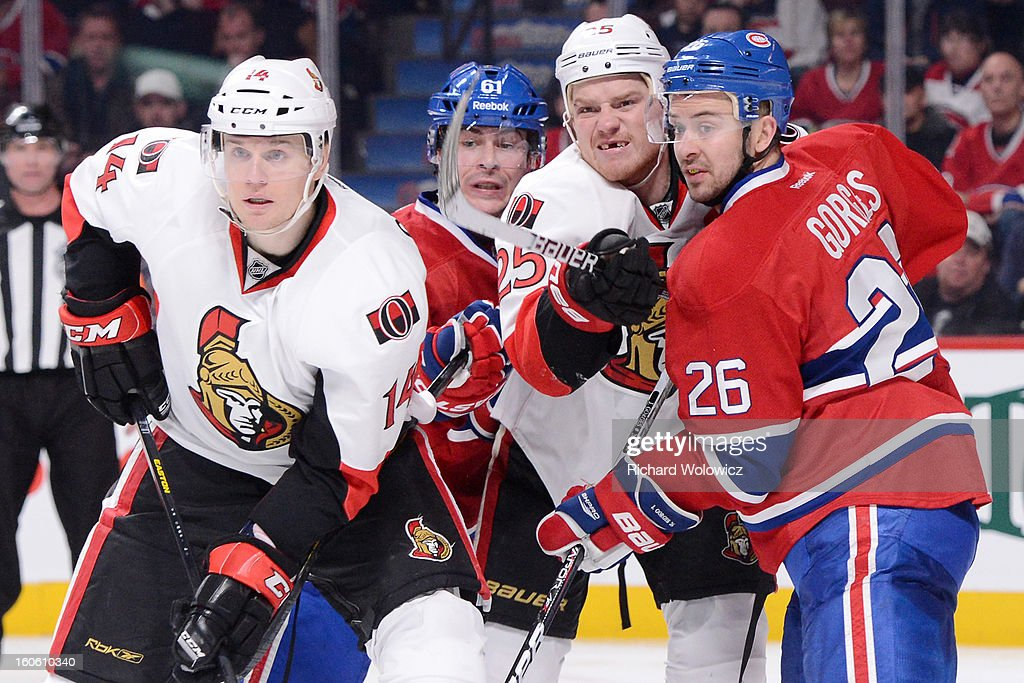 Josh Gorges #26 and Raphael Diaz #61 of the Montreal Canadiens defend against Chris Neil #25 and Colin Greening #14 of the Ottawa Senators during the NHL game at the Bell Centre on February 3, 2013 in Montreal, Quebec, Canada. The Canadiens defeated the Senators 2-1.