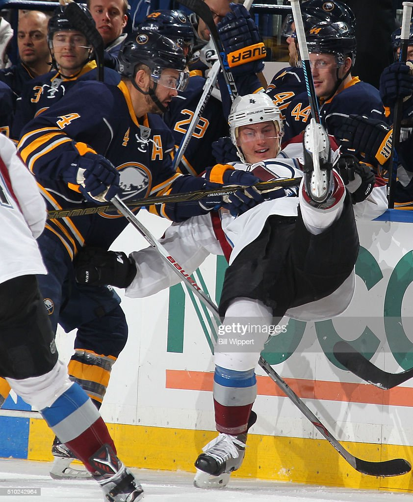 <a gi-track='captionPersonalityLinkClicked' href=/galleries/search?phrase=Josh+Gorges&family=editorial&specificpeople=550446 ng-click='$event.stopPropagation()'>Josh Gorges</a> #4 of the Buffalo Sabres checks <a gi-track='captionPersonalityLinkClicked' href=/galleries/search?phrase=Tyson+Barrie&family=editorial&specificpeople=4669265 ng-click='$event.stopPropagation()'>Tyson Barrie</a> #4 of the Colorado Avalanche during an NHL game on February 14, 2016 at the First Niagara Center in Buffalo, New York.