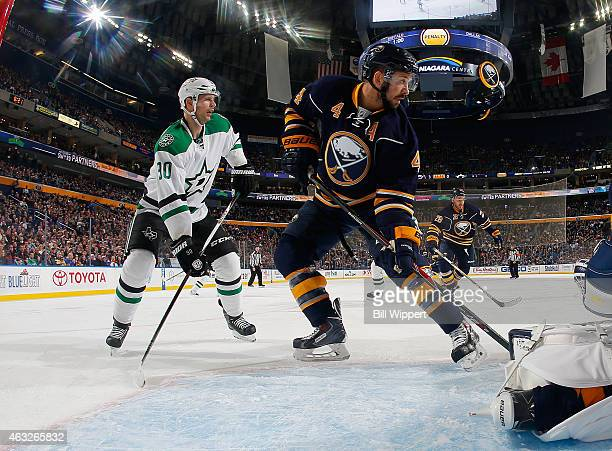 Josh Gorges of the Buffalo Sabres defends against Jason Spezza of the Dallas Stars on February 7 2015 at the First Niagara Center in Buffalo New York