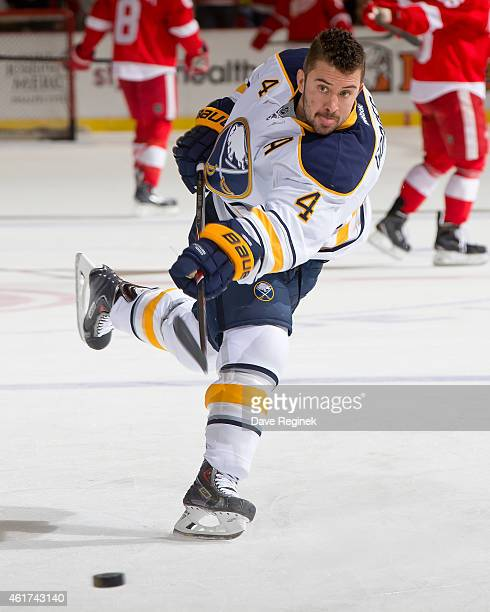 Josh Gorges of the Buffalo Sabres shoots the puck during pre game warmups before a NHL game against the Detroit Red Wings on January 18 2015 at Joe...