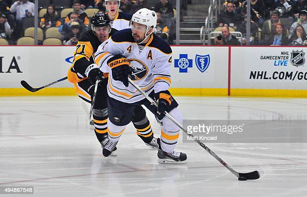 Josh Gorges of the Buffalo Sabres skates with the puck against the Pittsburgh Penguins during the game at Consol Energy Center on October 29 2015 in...