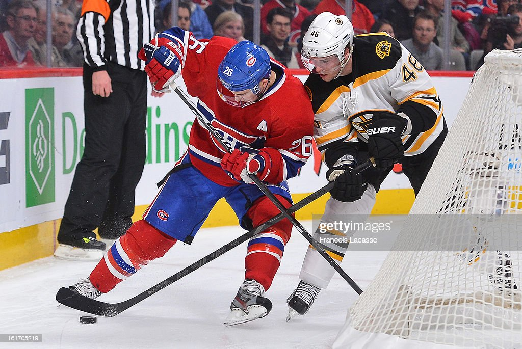 Josh Gorges #26 of the Montreal Canadiens and David Krejci #46 of the Boston Bruins battle for the puck during the NHL game on February 6, 2013 at the Bell Centre in Montreal, Quebec, Canada.