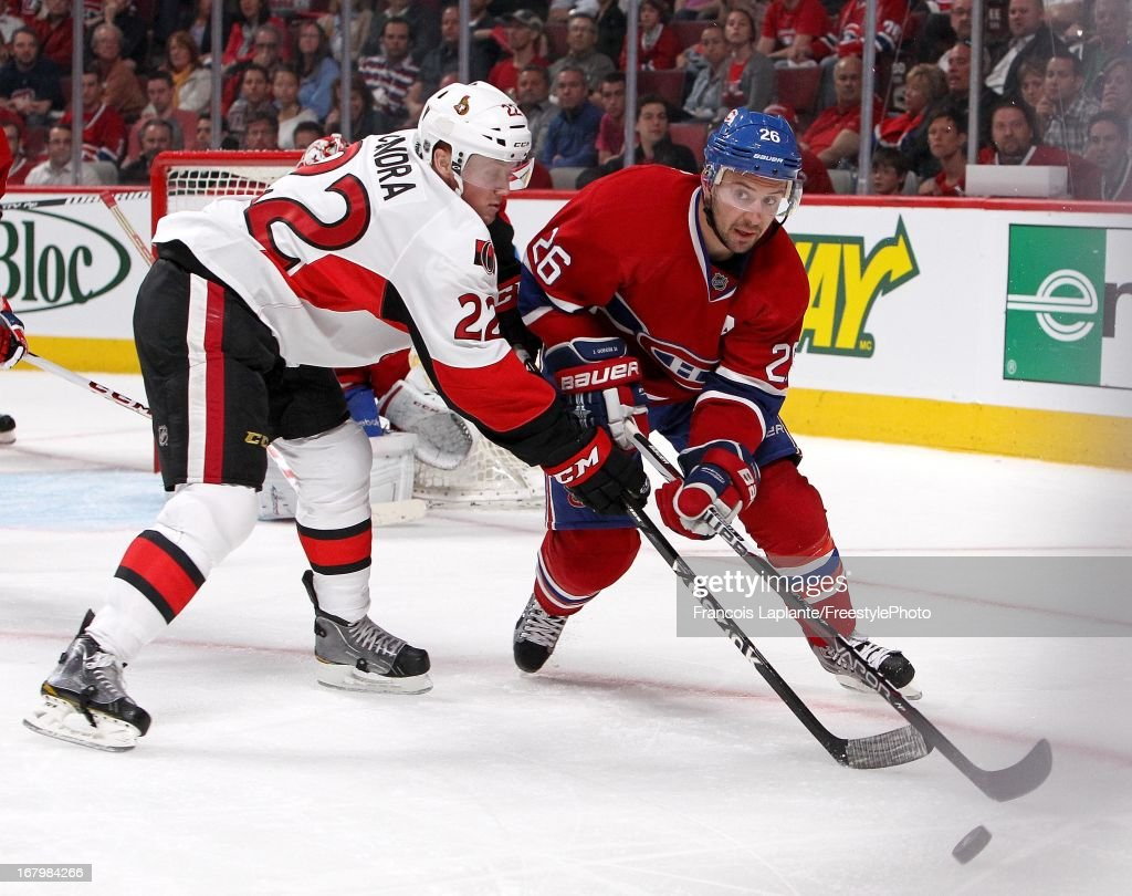 <a gi-track='captionPersonalityLinkClicked' href=/galleries/search?phrase=Josh+Gorges&family=editorial&specificpeople=550446 ng-click='$event.stopPropagation()'>Josh Gorges</a> #26 of the Montreal Canadiens battles for the puck against <a gi-track='captionPersonalityLinkClicked' href=/galleries/search?phrase=Erik+Condra&family=editorial&specificpeople=6254234 ng-click='$event.stopPropagation()'>Erik Condra</a> #22 of the Ottawa Senators in Game Two of the Eastern Conference Quarterfinals during the 2013 NHL Stanley Cup Playoffs at the Bell Centre on May 3, 2013 in Montreal, Quebec, Canada.