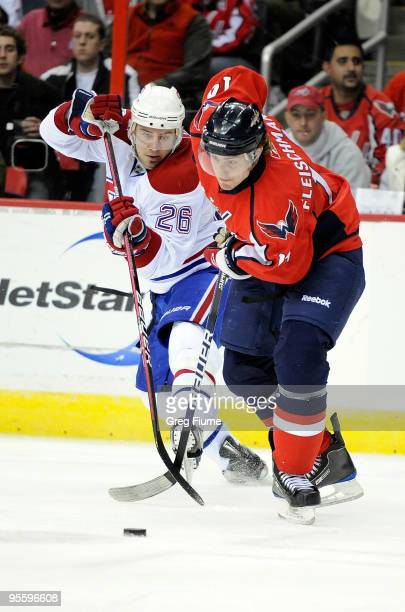 Josh Gorges of the Montreal Canadiens battles for the puck with Tomas Fleischmann of the Washington Capitals at the Verizon Center on January 5 2010...