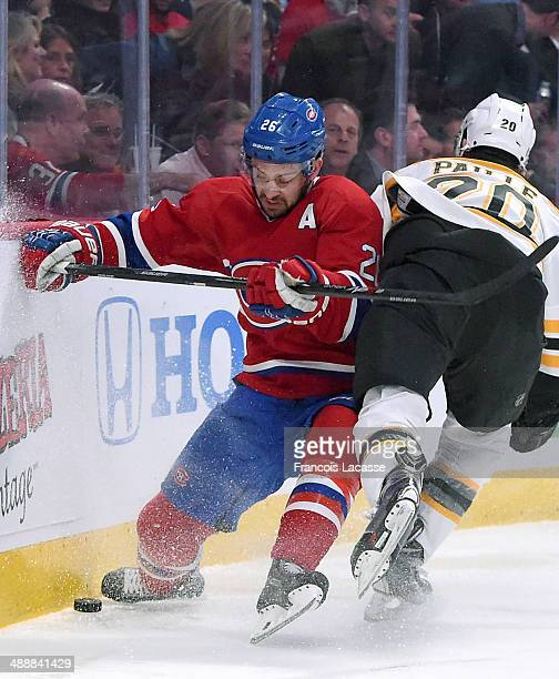 Josh Gorges of the Montreal Canadiens collides with Daniel Paille of the Boston Bruins in Game Four of the Second Round of the 2014 Stanley Cup...
