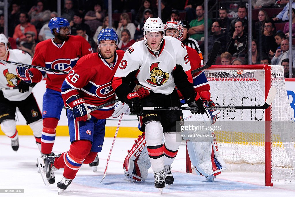 <a gi-track='captionPersonalityLinkClicked' href=/galleries/search?phrase=Josh+Gorges&family=editorial&specificpeople=550446 ng-click='$event.stopPropagation()'>Josh Gorges</a> #26 of the Montreal Canadiens defends against <a gi-track='captionPersonalityLinkClicked' href=/galleries/search?phrase=David+Dziurzynski&family=editorial&specificpeople=7183742 ng-click='$event.stopPropagation()'>David Dziurzynski</a> #59 of the Ottawa Senators during an NHL preseason game at the Bell Centre on September 26, 2013 in Montreal, Quebec, Canada. The Canadiens defeated the Senators 3-1.