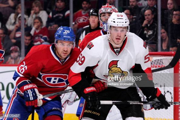 Josh Gorges of the Montreal Canadiens defends against David Dziurzynski of the Ottawa Senators during the NHL game at the Bell Centre on September 26...