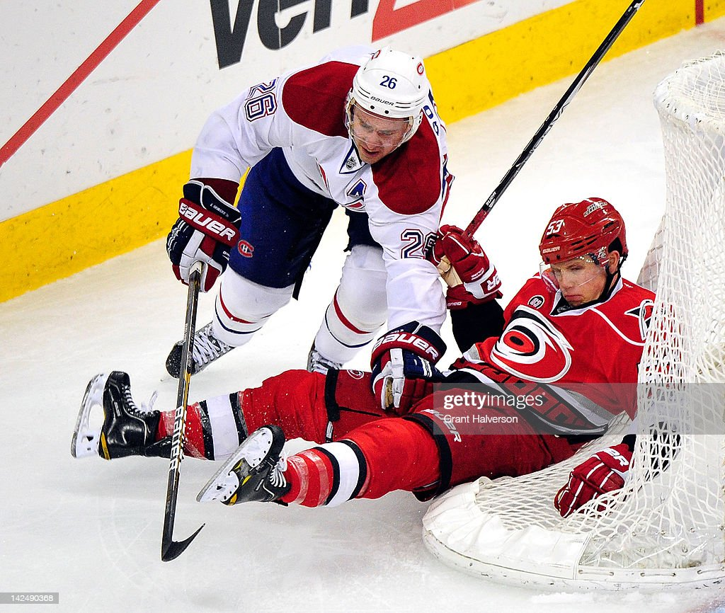 <a gi-track='captionPersonalityLinkClicked' href=/galleries/search?phrase=Josh+Gorges&family=editorial&specificpeople=550446 ng-click='$event.stopPropagation()'>Josh Gorges</a> #26 of the Montreal Canadiens drives <a gi-track='captionPersonalityLinkClicked' href=/galleries/search?phrase=Jeff+Skinner&family=editorial&specificpeople=3147596 ng-click='$event.stopPropagation()'>Jeff Skinner</a> #53 of the Carolina Hurricanes into the back of the goal during play at PNC Arena on April 5, 2012 in Raleigh, North Carolina. The Hurricanes won 2-1 by shootout.