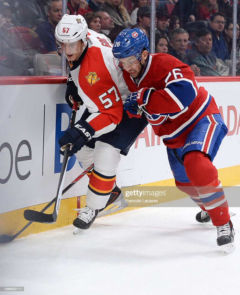 <a gi-track='captionPersonalityLinkClicked' href=/galleries/search?phrase=Josh+Gorges&family=editorial&specificpeople=550446 ng-click='$event.stopPropagation()'>Josh Gorges</a> #26 of the Montreal Canadiens fights for the puck against <a gi-track='captionPersonalityLinkClicked' href=/galleries/search?phrase=Marcel+Goc&family=editorial&specificpeople=541626 ng-click='$event.stopPropagation()'>Marcel Goc</a> #57 of the Florida Panthers during the NHL game on December 15, 2013 at the Bell Centre in Montreal, Quebec, Canada.